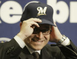 WIMG103 - Mark Attanasio puts on a Milwaukee Brewers hat at a news conference Monday, Oct. 4,...