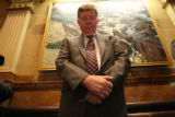 Colorado rookie lawmaker Douglas Bruce bows his head during a prayer in the Colorado House...