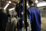 Troop 685 Boy Scout Toby Mullarkey (cq), 13, stands in front of the flag he and the rest of his...
