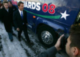 Democratic Presidential candidate John Edwards boards his bus after rallying his supporters on the...