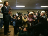 Photographers surround Democratic Presidential candidate John Edwards as he rallies his supporters...