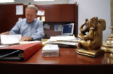 A brass elephant bookend symbolising the Republican party sits on the desk of John Ramsey as he...