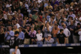 Rockies fans give starting pitcher Josh Fogg a standing ovation as he leaves the game in the fifth...