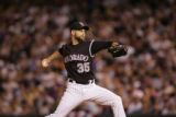 Rockies pitcher Taylor Buchholz delivers a pitch in the fifth innin during the Rockies National...