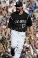 Colorado Rockies Todd Helton reacts to the final out after the Rockies defeated the Arizona...