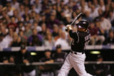 Colorado Rockies pinch hitter Seth Smith hits a triple in the sixth inning during their National...