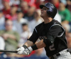 Colorado Rockies batter Troy Tulowitzki watches his first inning home run leave the park against...