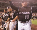 Colorado Rockies Matt Holliday (5) is helped to the clubhouse after his homeplate collision on the...