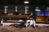 Colorado Rockies catcher Yorvit Torrealba takes a break in the dug out from celebrating the...