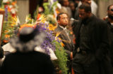 [JPM0096] Broncos linebacker Al Wilson pauses at the casket at the funeral of Denver Broncos...