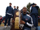 Mike Buggs took his turn posing with the championship trophy after Metro State honored its...