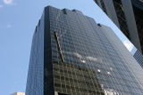Buffeted by high winds, two window washer take a wild ride 12 to 15 stories above ground at the...