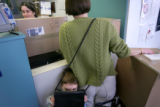 (12/14/2004)Denver, Colorado-Will Crockett, 3, Denver, accompanies his mother Amy as she mails...