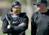 4012 Colorado Rockies' catcher Yovit Torrealba and manager Clint Hurdle chat during Spring...