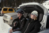 Paul Ribich (cq), left and his wife Kim Ribich, sit in the trunk of their car after spending the...