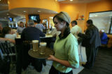 Waitress Karissa Lickteig (cq) serves up a few lattes at the new Village Inn in Wheatridge, Colo,...