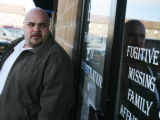 Employee Mike Delprette stands outside Focus Bureau of Investigations near where the car owned by...