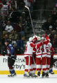 The Detroit Red Wings celebrate a goal by Valterri Flippula in the first period of the Colorado...