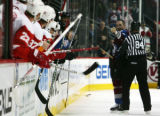 Ian Laperriere points to the Red Wings bench after fighting with Aaron Downey in the first period...