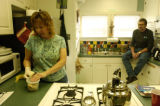 (DENVER Colo., December 8, 2004)  Karen Johnson (left) cleans the kitchen and talks to resident...