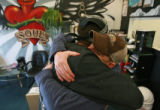 "DM0875   David ""Doc"" Anderson, right, gets a hug from Kyle Anderson at the Ink for the..."