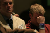 DM0371   CU Boulder sophomore Dan Omasta, right, shows his disappointment with the Board of...