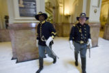 DM0798   Paul McCowan, left, and Dick Werpy, members of the Buffalo Soldiers,  walk through the...