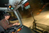 Vail Resorts Snowcat driver Paul Jaeger makes his evening grooming rounds at Vail Mountain on...