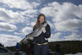 Kelly Schroeder (cq) of Denver smells her 16 pound salmon before tossing it during the Sundance...