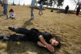 MJM151  Asbury Elementary School student, Zion Cherilla, 8, rolls down a hill near the South...