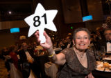 (Denver, Colo., March 8, 2008) Adele Gelfand holds up her bid paddle to make a donation.  Beaux...