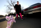 N0312PINK1.JPG N0312PINK1.JPG Joy Douglas (cq) walks her pink poodle, Cici, to the Boulder County...