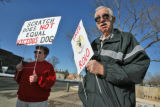 L to R : Carole Soucie (cq) and her husband Al Soucie (cq) holds signs of support for Rolo, a...