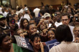 Michelle Obama greets a enthusiastic crowd after speaking in the University Center on the...