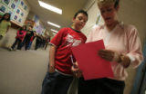 DM0659   Second grade teacher Ms. Deanna Blunt asks Geno Domenico what you have to do to find the...