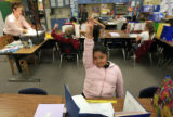 DM0657   Delilah Flores raises her hand in Ms. Deanna Blunt's second grade class at Valley View...