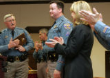 The Colorado State Patrol honors  Trooper Jay Hemphill, center, with the Colorado State Patrol...