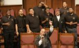 Hank Neal, music director for Wheeler Avenue Baptist Church in Houston, center, Texas, leads the...