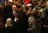 Washington D.C. mayor Adrian Fenty, center, is greeted by members of Wheeler Avenue Baptist Church...