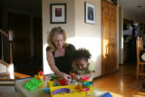 Lanae, 4 (cq) gets help from her mother Jana Zinser (cq) as she squishes playdough down to make...