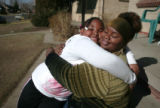Niishia Hysaw 18 is hugged by her sister Netesha Hysaw, 8 infront of their Park Hill home Tuesday...