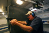 Max Cochran target shoots at the Green Mountain Family Shooting Center in Lakewood, Colo., on...