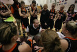 In Class 4A Girls BB first round Sterling's coach Doug Holloway preps his players during their...