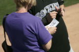 00227 Colorado Rockies' Troy Tulowitzki signs an autograph as the Rockies beat the Chicago White...