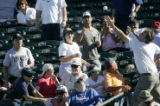 00262 fans go after a foul ball as the Colorado Rockiesbeat the Chicago White Sox at Tucson...