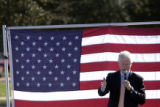 While on the campaign trail for Hillary Clinton, Bill Clinton speaks to a small crowd in the...