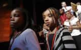 (at right) 9 year-old Latisha Holmes (cq), from Wyatt Edison Middle School in Denver walks off the...