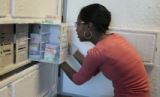 Sara Hunegnaw (cq), a grad student at CU, takes some cells out of the -80 degree freezer, to be...
