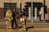 MJM186  Firefighters confer outside Lumberg Elementary School in Edgewater, Colo. Wednesday...
