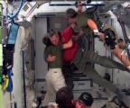 DN301 - In this image from NASA TV, Space Shuttle Endeavour commander Dominic Gorie, center, hugs...